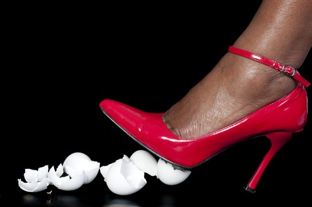 womens clothing: A woman in high heels walking on eggshells