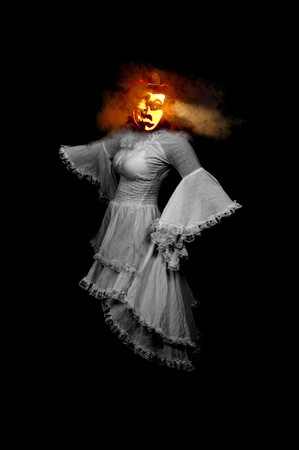 goblins: A Jack-O-Lantern headed woman floating in the dark. Stock Photo