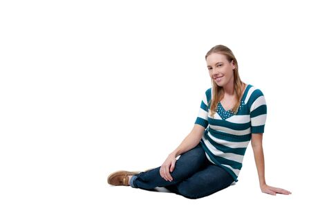 hot chick: A beautiful young woman sitting on the floor Stock Photo
