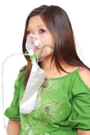 disease cure: A beautiful young woman wearing an oxtgen mask