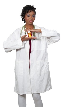 opthalmascope: An doctor holding prescription medication in her office