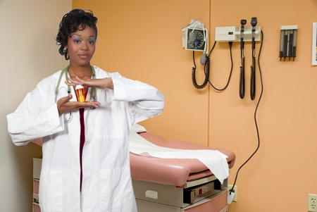 sphygmonanometer: An doctor holding prescription medication in her office