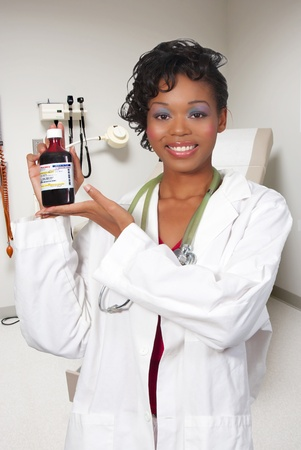 An woman doctor holding a bottle of prescription medication  Stock Photo - 8306402