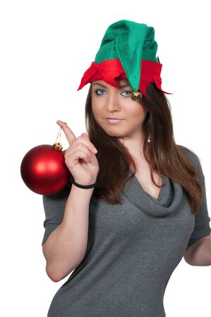 A beautiful young woman elf holding a Christmas Tree Ornament photo