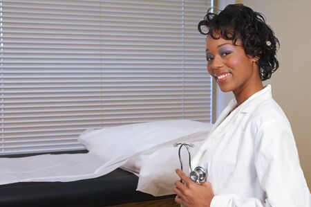 A beautiful black woman medical doctor in a lab coat photo