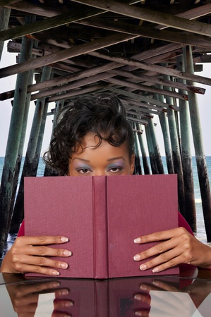 A young African American woman reading a book Stock Photo - 8430049