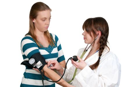 sphygmonanometer: A woman doctor checking a patient blood pressure