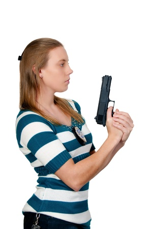 A beautiful police detective woman on the job with a gun Stock Photo - 8672274