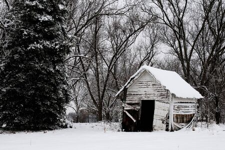 An old abandoned outbuilding covered in a winter snow storm Stock Photo - 8672798