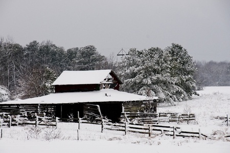 An old abandoned horse stable covered in a winter blizzard snow storm Stock Photo - 8672555