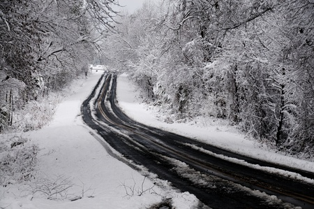 inclement: A snow storm on a mountain two lane highway Stock Photo
