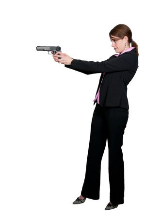 A beautiful police detective woman on the job with a gun Stock Photo - 8671837