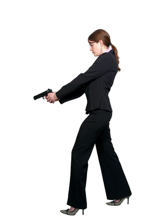 A beautiful police detective woman on the job with a gun Stock Photo - 8671828