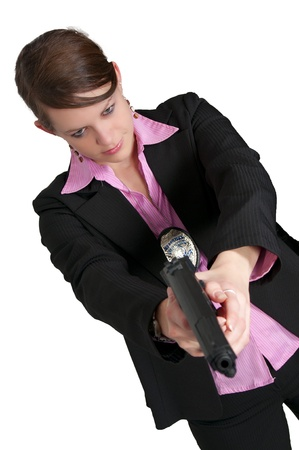 A beautiful police detective woman on the job with a gun Banco de Imagens - 8672428