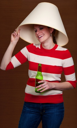 lamp shade: Women drinking adult beverages at a party wearing a lampshade Stock Photo