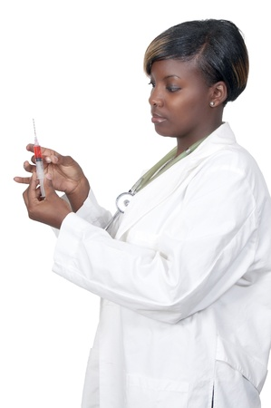 A black African American woman doctor preparing a shot for a patient Stock Photo - 8671845