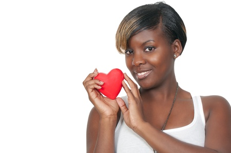 A beautiful young African American black woman holding a Valentines Day heart Stock Photo - 8671859