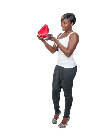 A beautiful young black African American woman holding a Valentines Day heart box gift present Stock Photo - 8671825