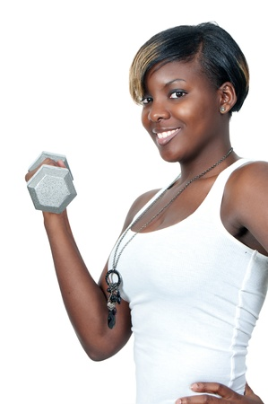 A beautiful young black African American woman working out with a dumbbell weight