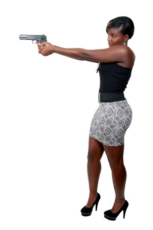 A beautiful police detective woman on the job with a gun Stock Photo - 8671864