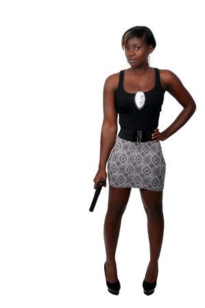 A beautiful police detective woman on the job with a gun Stock Photo - 8671822