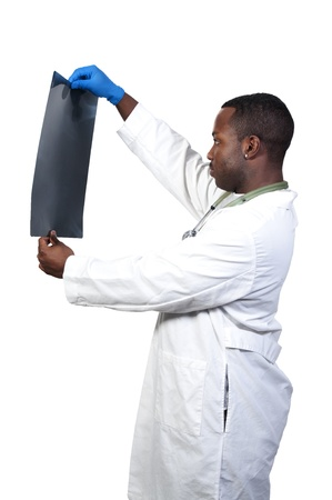 Black African American man radiologist looking at a patients x-ray. photo
