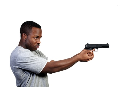 A black African American police detective man on the job with a gun Stock Photo - 8672852
