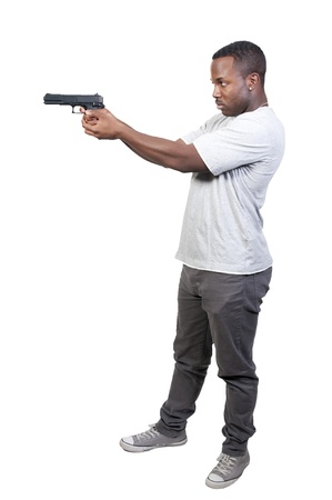 A black African American police detective man on the job with a gun Stock Photo - 8672835