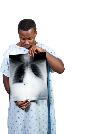 A black African American man patient holding an x-ray photo