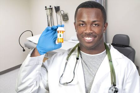 Black man African American holding a prescription medication pill bottle Stock Photo - 8672860