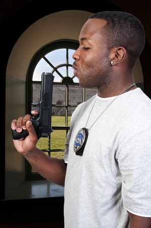 A black African American police detective man on the job with a gun Stock Photo - 8672918