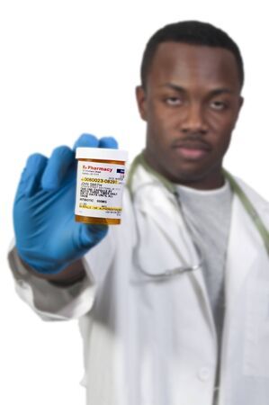 prescription medication pill bottle being held by a blurred Black man African American doctor Stock Photo - 8890855