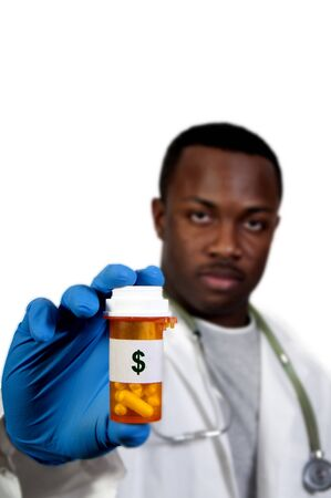 prescription medication pill bottle being held by a blurred Black man African American doctor Stock Photo - 8890861