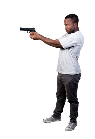 A black African American police detective man on the job with a gun Stock Photo - 8890854