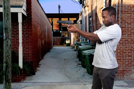 A black African American police detective man on the job with a gun Stock Photo - 8891116