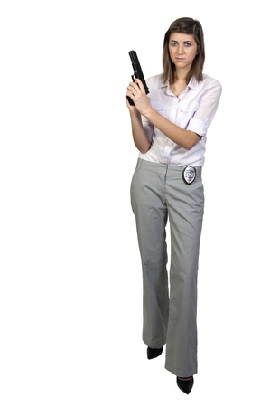 A beautiful police detective woman on the job with a gun Stock Photo - 8890857