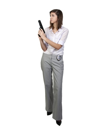 A beautiful police detective woman on the job with a gun Banco de Imagens - 8890848