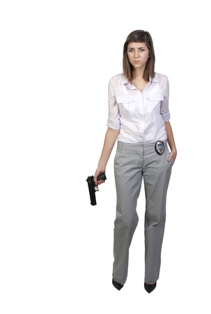 A beautiful police detective woman on the job with a gun Banco de Imagens - 8890841