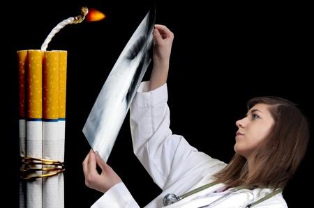 A beautiful female radiologist examining an x-ray