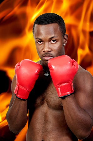 A black African American man athletic boxer with boxing gloves photo