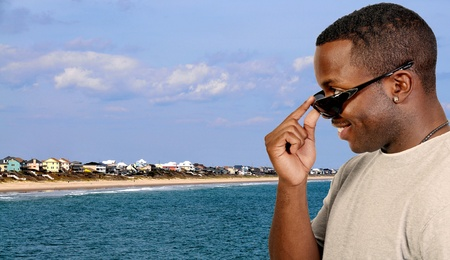 A black african american man wearing a pair of sun glasses photo