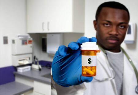 prescription medication pill bottle being held by a blurred black african american doctor photo