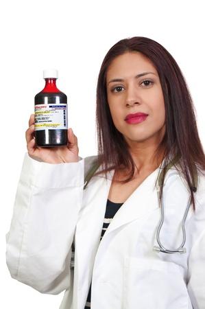 A Hispanic woman doctor holding a bottle of prescription medication  Stock Photo - 8892161