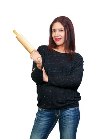 A beautiful young hispanic latino woman holding a rolling pin Stock fotó