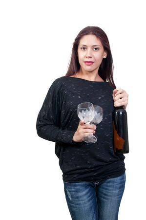 A beautiful Hispanic Latino woman holding wine glasses and bottle photo