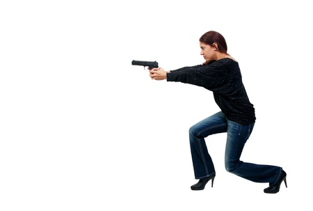 A young and beautiful Hispanic woman police detective holding a handgun  photo