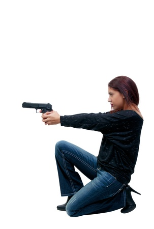 45 gun: A young and beautiful Hispanic woman police detective holding a handgun