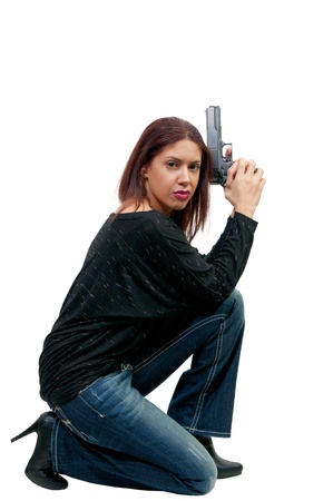 A young and beautiful woman police detective holding a handgun  photo