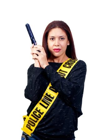 sash: A young and beautiful woman holding a handgun wearing police line tape as a sash