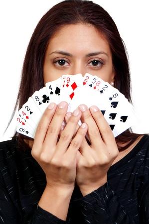 A beautiful hispanic woman playing cards - lady luck photo